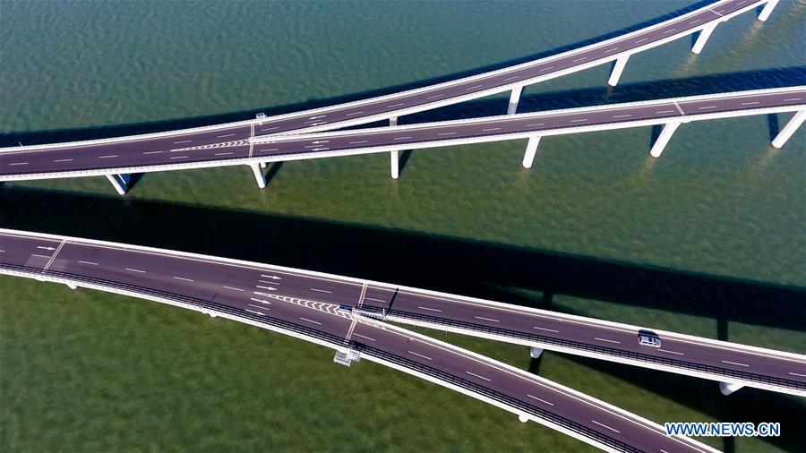Aerial photo taken on June 1, 2018 shows the Qingdao Jiaozhou Bay Bridge in Qingdao, east China's Shandong Province. The 36.48-km cross-sea bridge connects the urban district of Qingdao City to its Huangdao district. (Xinhua/Guo Xulei)
