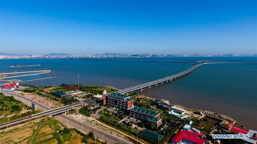 Aerial photo taken on June 1, 2018 shows the Qingdao Jiaozhou Bay Bridge in Qingdao, east China's Shandong Province. The 36.48-km cross-sea bridge connects the urban district of Qingdao City to its Huangdao district. (Xinhua/Guo Xulei)<br/>