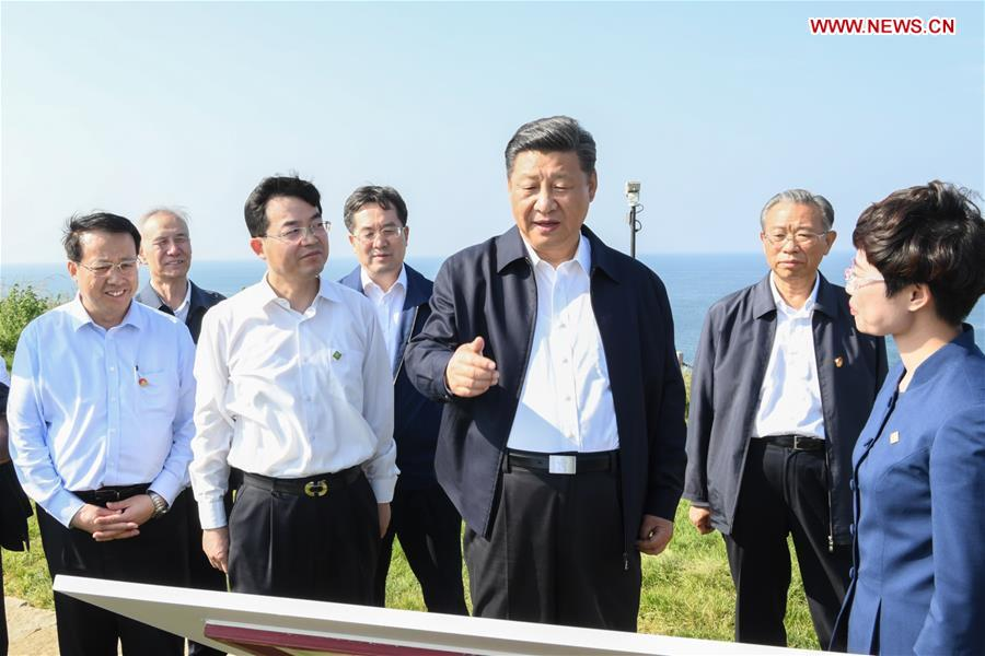 Chinese President Xi Jinping, also general secretary of the Communist Party of China Central Committee and chairman of the Central Military Commission, visits a fort relic site on Liugong Island during an inspection tour in Weihai, east China's Shandong Province, June 12, 2018. (Xinhua/Li Xueren)