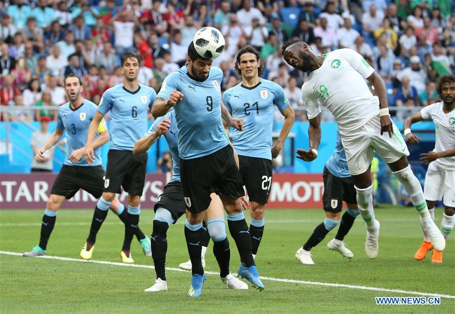 Luis Suarez (L front) of Uruguay competes for a header with Fahad Almuwallad (R front) of Saudi Arabia during a Group A match between Uruguay and Saudi Arabia at the 2018 FIFA World Cup in Rostov-on-Don, Russia, June 20, 2018. (Xinhua/Li Ming)<br/>