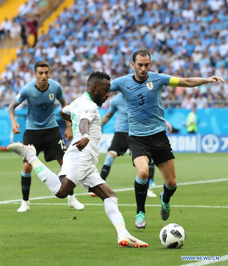 Fahad Almuwallad (C) of Saudi Arabia vies with Diego Godin (R) of Uruguay during a Group A match between Uruguay and Saudi Arabia at the 2018 FIFA World Cup in Rostov-on-Don, Russia, June 20, 2018. (Xinhua/Lu Jinbo)<br/>