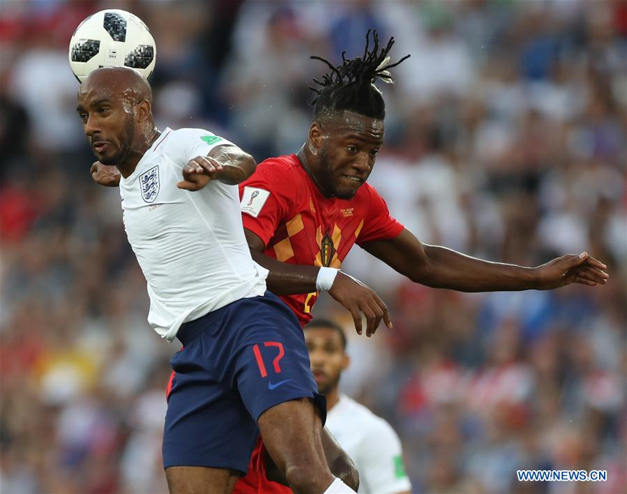 Fabian Delph (L) of England competes for a header with Michy Batshuayi of Belgium during the 2018 FIFA World Cup Group G match between England and Belgium in Kaliningrad, Russia, June 28, 2018. (Xinhua/Xu Zijian)<br/>
