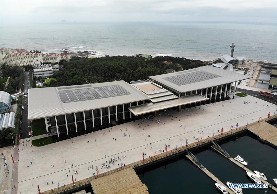 Aerial photo taken on July 1, 2018 shows the Olympic sailing center in Qingdao of east China's Shandong Province. The center, used as the conference hall during the 18th Shanghai Cooperation Organization (SCO) summit, after a brief remodification, was opened to the public from this Sunday. (Xinhua/Li Ziheng)<br/>