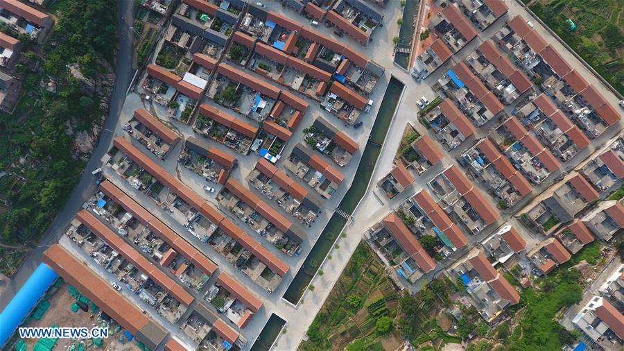 Aerial photo taken on July 5, 2018 shows in the Muyun'an community of Rongcheng City, east China's Shandong Province. The Muyun'an community is famous for painting and is dedicated to boosting tourism based on cultural heritages. (Xinhua/Wang Nan)<br/>