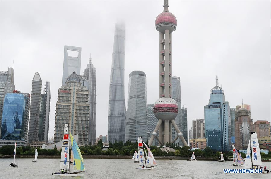 Sailboats are seen on the Huangpu River during activity marking the 2018 Maritime Day of China in east China's Shanghai, July 11, 2018. The 2018 Maritime Day of China was observed on Wednesday. (Xinhua/Fang Zhe)<br/>