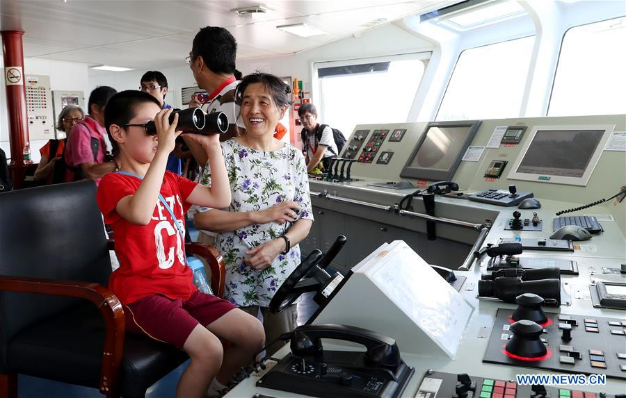 Local residents visit the Dong Hai Jiu 101 rescue vessel during a ship open day activity marking the 2018 Maritime Day of China in east China's Shanghai, July 11, 2018. The 2018 Maritime Day of China was observed on Wednesday. (Xinhua/Fang Zhe)<br/>