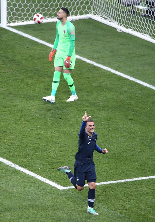 Antoine Griezmann (bottom) of France celebrates scoring during the 2018 FIFA World Cup final match between France and Croatia in Moscow, Russia, July 15, 2018. (Xinhua/Li Ming)<br/>