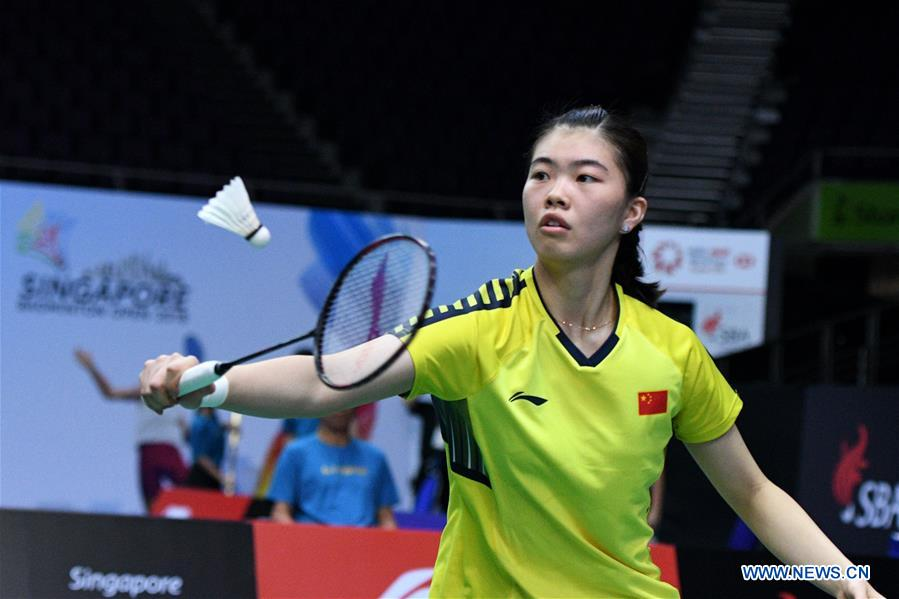 Gao Fangjie of China hits a return during the women's singles second round match against Busanan Ongbamrungphan of Thailand at 2018 Singapore Badminton Open held at Singapore Indoor Stadium in Singapore, on July 19, 2018. Gao Fangjie won by 2-0. (Xinhua/Then Chih Wey)<br/>