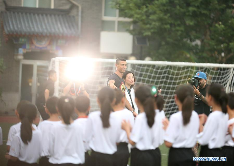 Portuguese football player Cristiano Ronaldo meets students as he attends a promotional event in Beijing, capital of China, on July 19, 2018. (Xinhua/Cao Can)<br/>