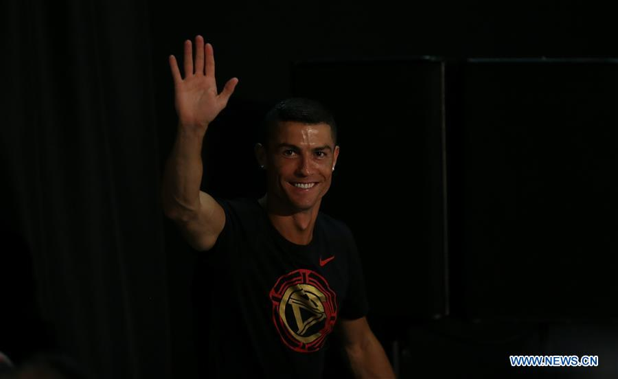 Portuguese football player Cristiano Ronaldo greets fans as he attends a promotional event in Beijing, capital of China, on July 19, 2018. (Xinhua/Cao Can)<br/>