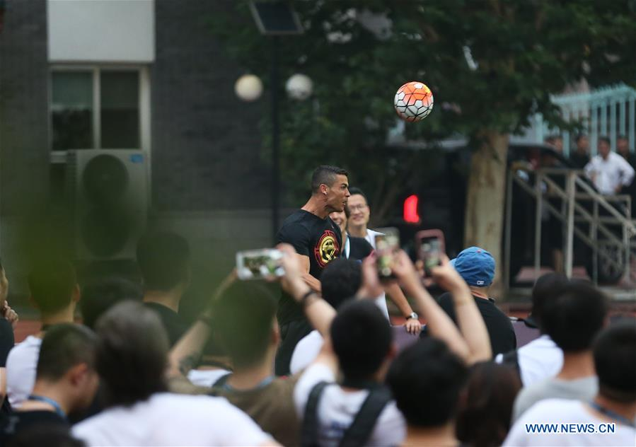 Portuguese football player Cristiano Ronaldo interacts with students as he attends a promotional event in Beijing, China, on July 19, 2018. (Xinhua/Cao Can)