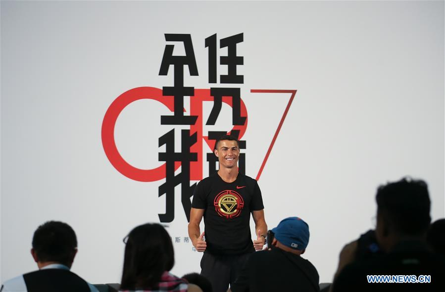 Portuguese football player Cristiano Ronaldo gestures as he attends a promotional event in Beijing, capital of China, on July 19, 2018. (Xinhua/Cao Can)<br/>