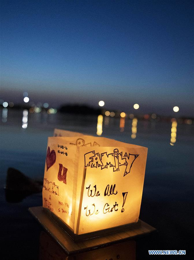 Photo taken on Aug. 4, 2018 shows a floating water lantern during a water lantern festival at National Habor in Maryland, the United States. Lanterns were set afloat to glow on the Potomac River for the Water Lantern Festival on Saturday, creating a spectacular and glistening light display. (Xinhua/Liu Jie)<br/>