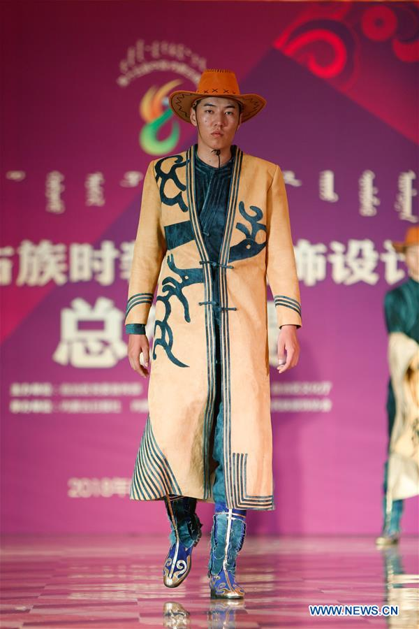 A model presents creations during a design contest of Mongolian costumes in Hohhot, north China's Inner Mongolia Autonomous Region, Aug 5, 2018. (Xinhua/Yu Dongsheng)<br/>