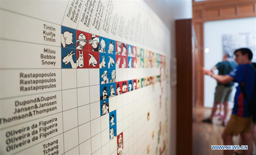 Tourists visit an area displaying the Tintin Adventures at the Comics Art Museum in Brussels, Belgium, Aug. 12, 2018. The Comics Art Museum is located in the heart of Brussels, where great comic artists created renowned characters such as Tintin and the Smurfs. As one of the main attractions of Brussels, the museum, with its 4,200 square meters of permanent and temporary exhibitions, plays an important role in cultural exchanges and tourism of Belgium. (Xinhua/Zheng Huansong)<br/>