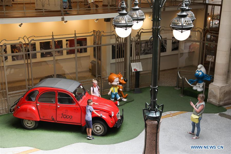 Tourists visit the Comics Art Museum in Brussels, Belgium, Aug. 12, 2018. The Comics Art Museum is located in the heart of Brussels, where great comic artists created renowned characters such as Tintin and the Smurfs. As one of the main attractions of Brussels, the museum, with its 4,200 square meters of permanent and temporary exhibitions, plays an important role in cultural exchanges and tourism of Belgium. (Xinhua/Zheng Huansong)<br/>