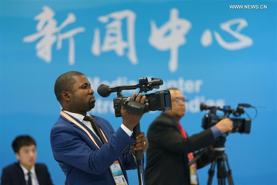 A journalist from the Republic of Congo works at the Media Center of the 2018 Beijing Summit of the Forum on China-Africa Cooperation (FOCAC) in Beijing, capital of China, Sept. 4, 2018. More than 2,600 journalists from home and abroad have registered to cover the forum. (Xinhua/Ju Huanzong)