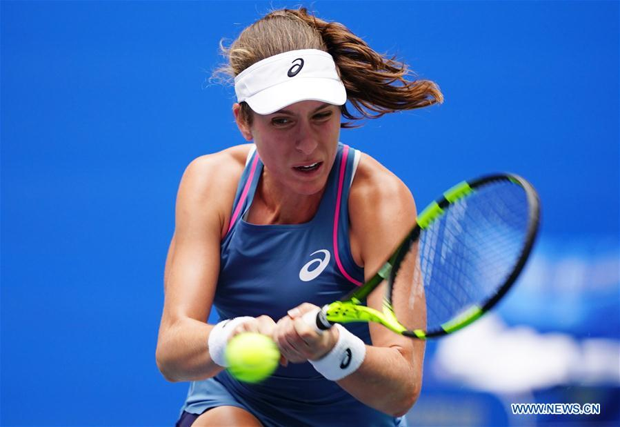 Johanna Konta of Britain hits a return during the singles round 1 match against Ashleigh Barty of Australia at the 2018 WTA Wuhan Open tennis tournament in Wuhan of central China's Hubei Province, on Sept. 24, 2018. (Xinhua/Song Zhenping)<br/>
