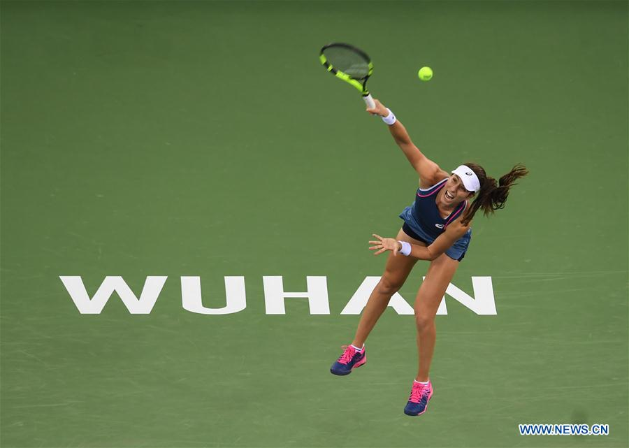 Johanna Konta of Britain serves during the singles round 1 match against Ashleigh Barty of Australia at the 2018 WTA Wuhan Open tennis tournament in Wuhan of central China's Hubei Province, on Sept. 24, 2018. (Xinhua/Xiao Yijiu)<br/>
