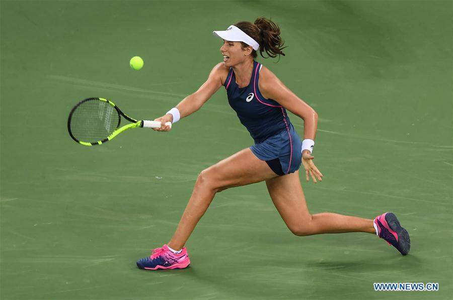 Johanna Konta of Britain hits a return during the singles round 1 match against Ashleigh Barty of Australia at the 2018 WTA Wuhan Open tennis tournament in Wuhan of central China's Hubei Province, on Sept. 24, 2018. (Xinhua/Xiao Yijiu)<br/>