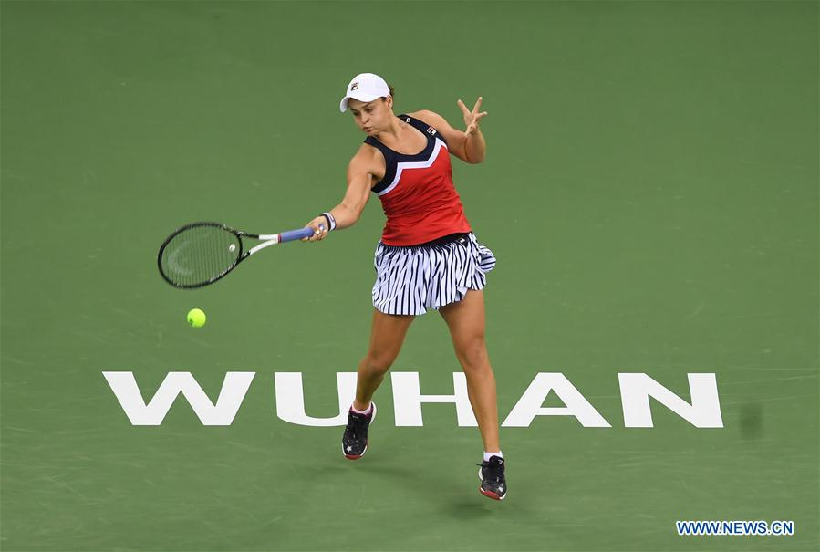 Ashleigh Barty of Australia hits a return during the singles round 1 match against Johanna Konta of Britain at the 2018 WTA Wuhan Open tennis tournament in Wuhan of central China's Hubei Province, on Sept. 24, 2018. (Xinhua/Xiao Yijiu)
