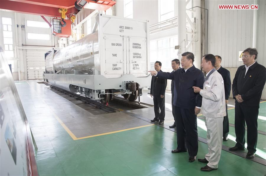 Chinese President Xi Jinping, also general secretary of the Communist Party of China (CPC) Central Committee and chairman of the Central Military Commission, visits a research center of China Railway Rolling Stock Corporation (CRRC) Qiqihar Co. in Qiqihar, northeast China's Heilongjiang Province, Sept. 26, 2018. Xi inspected Qiqihar on Wednesday. (Xinhua/Wang Ye)<br/>