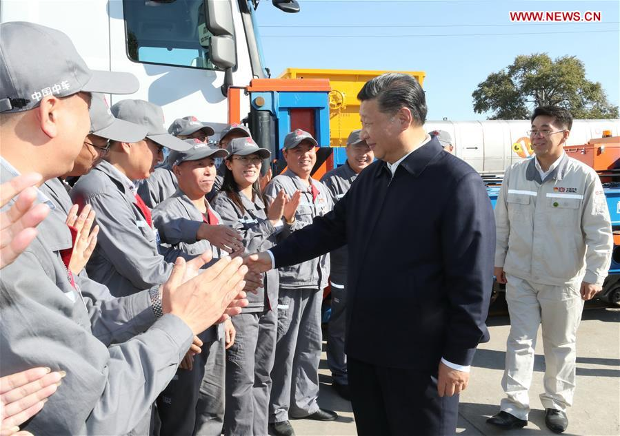 Chinese President Xi Jinping, also general secretary of the Communist Party of China (CPC) Central Committee and chairman of the Central Military Commission, shakes hands with workers during his visit to China Railway Rolling Stock Corporation (CRRC) Qiqihar Co. in Qiqihar, northeast China's Heilongjiang Province, Sept. 26, 2018. Xi inspected Qiqihar on Wednesday. (Xinhua/Ju Peng)<br/>