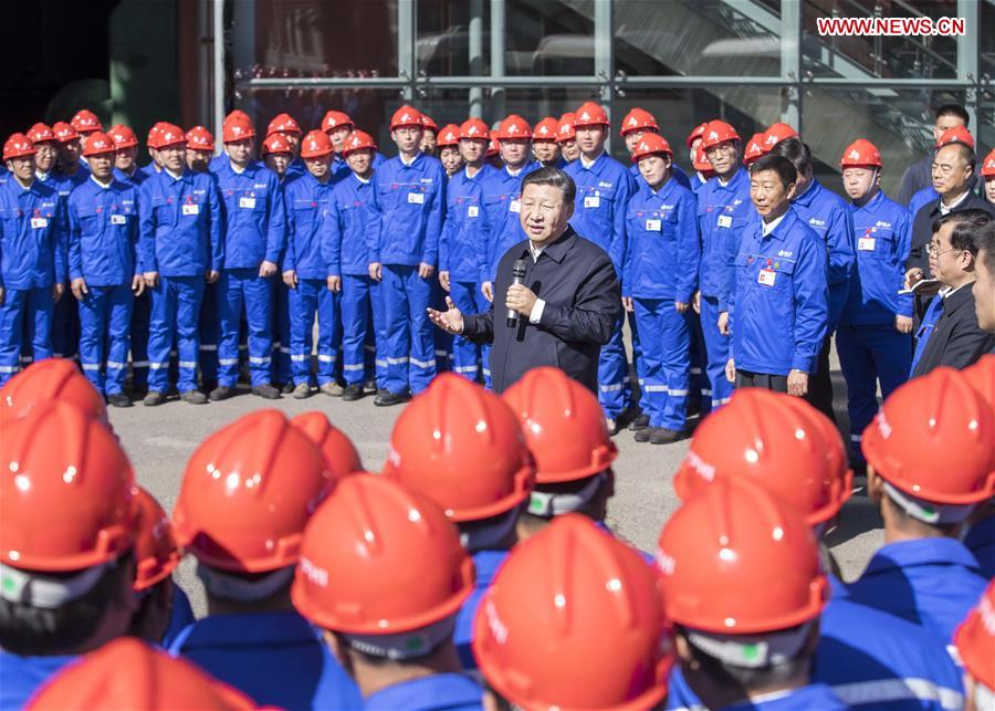 Chinese President Xi Jinping, also general secretary of the Communist Party of China (CPC) Central Committee and chairman of the Central Military Commission, speaks to workers during his visit to China First Heavy Industries (CFHI) in Qiqihar, northeast China's Heilongjiang Province, Sept. 26, 2018. Xi inspected Qiqihar on Wednesday. (Xinhua/Wang Ye)
