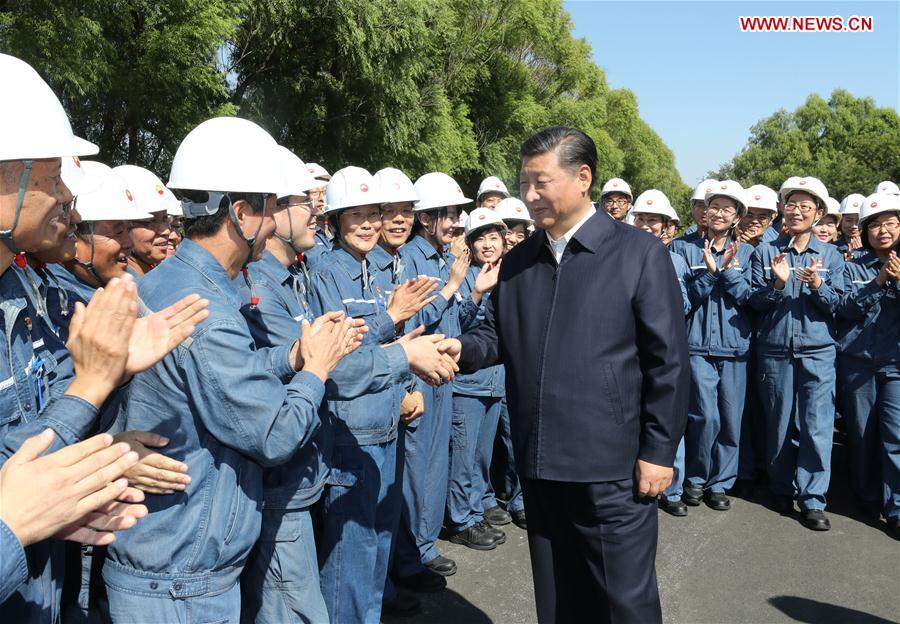 Chinese President Xi Jinping, also general secretary of the Communist Party of China (CPC) Central Committee and chairman of the Central Military Commission, shakes hands with workers during his visit to China National Petroleum Corporation (CNPC) Liaoyang Petrochemical Company in Liaoyang, northeast China's Liaoning Province, Sept. 27, 2018. Xi started an inspection tour in Liaoning on Thursday. (Xinhua/Ju Peng)<br/>