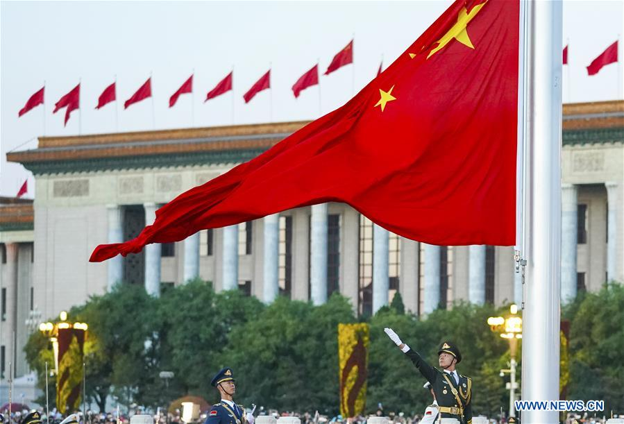 A national flag raising ceremony is held at the Tian'anmen Square in Beijing, capital of China, on Oct. 1, 2018, the National Day, to celebrate the 69th anniversary of the founding of the People's Republic of China. (Xinhua/Yin Gang)<br/>