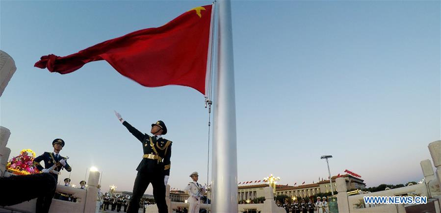 A national flag raising ceremony is held at the Tian'anmen Square in Beijing, capital of China, on Oct. 1, 2018, the National Day, to celebrate the 69th anniversary of the founding of the People's Republic of China. (Xinhua/Li Gang)<br/>