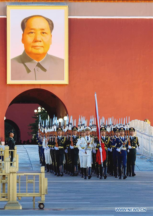 The guard of honor escorts the national flag for a flag-raising ceremony at the Tian'anmen Square in Beijing, capital of China, on Oct. 1, 2018, the National Day, to celebrate the 69th anniversary of the founding of the People's Republic of China.(Xinhua/Liu Jinhai)<br/>