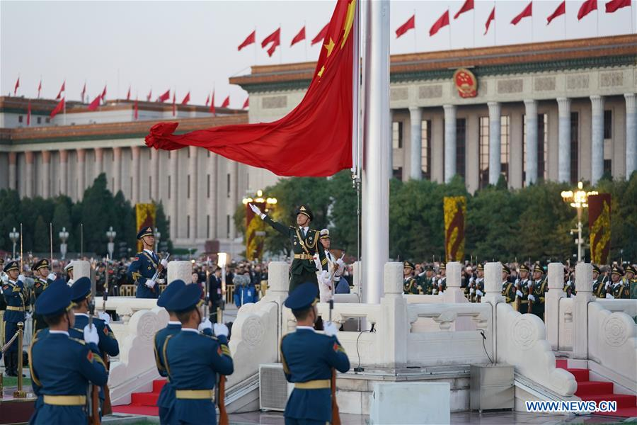 A national flag raising ceremony is held at the Tian'anmen Square in Beijing, capital of China, on Oct. 1, 2018, the National Day, to celebrate the 69th anniversary of the founding of the People's Republic of China. (Xinhua/Ju Huanzong)