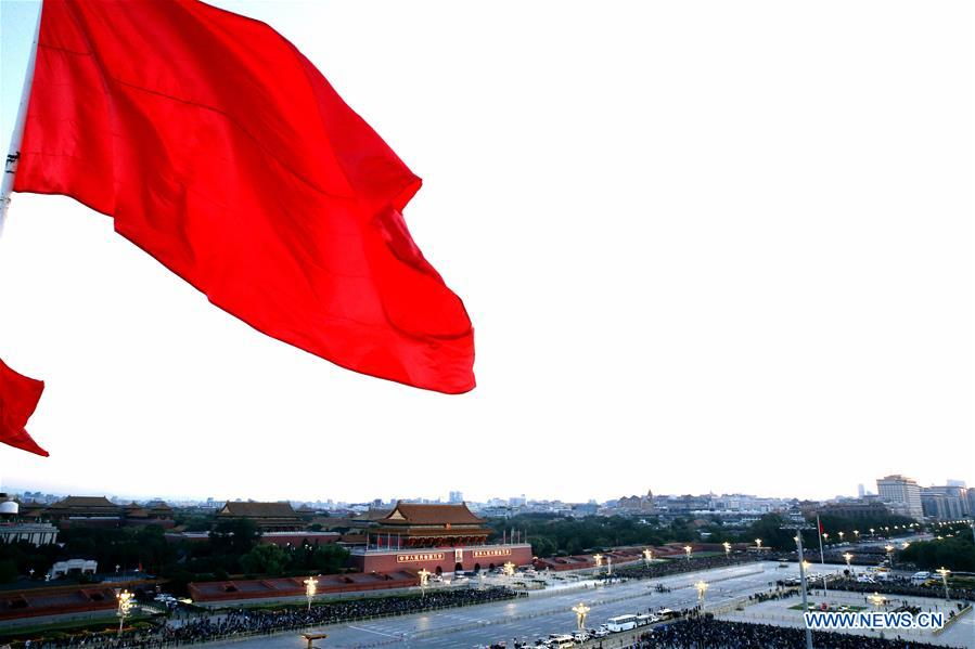 A national flag raising ceremony is held at the Tian'anmen Square in Beijing, capital of China, on Oct. 1, 2018, the National Day, to celebrate the 69th anniversary of the founding of the People's Republic of China. (Xinhua/Zhang Yuwei)<br/>