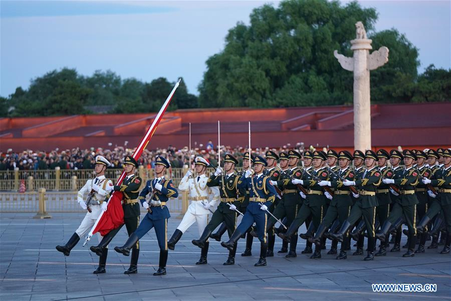 The guard of honor escorts the national flag for a flag-raising ceremony at the Tian'anmen Square in Beijing, capital of China, on Oct. 1, 2018, the National Day, to celebrate the 69th anniversary of the founding of the People's Republic of China.(Xinhua/Ju Huanzong)<br/>
