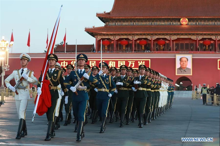 The guard of honor escorts the national flag for a national flag-raising ceremony in a celebration of the National Day at the Tian'anmen Square in central Beijing, capital of China, on Oct. 1, 2018, the 69th anniversary of the founding of the People's Republic of China. (Xinhua/Ju Zhenhua)<br/>A ceremony for raising the National Flag was held early Monday morning at the Tian'anmen Square in downtown Beijing to celebrate the 69th anniversary of the founding of the People's Republic of China (PRC).<br/>The Guard of Honor of the Chinese People's Liberation Army escorted the national flag to the square, while the military band played the national anthem.Around 145,000 people from across China gathered at the square to watch the ceremony.<br/>Tian'anmen Square witnessed the raising of the first PRC national flag on Oct. 1, 1949, marking a great new start for the Chinese people.<br/>
