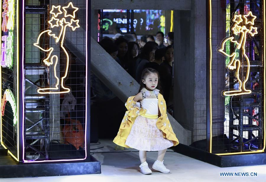 A model presents a creation during the China International Children's Fashion Week in Shanghai, east China, Oct. 4, 2018. The fashion week ended on Sunday. (Xinhua/Chen Jianli)