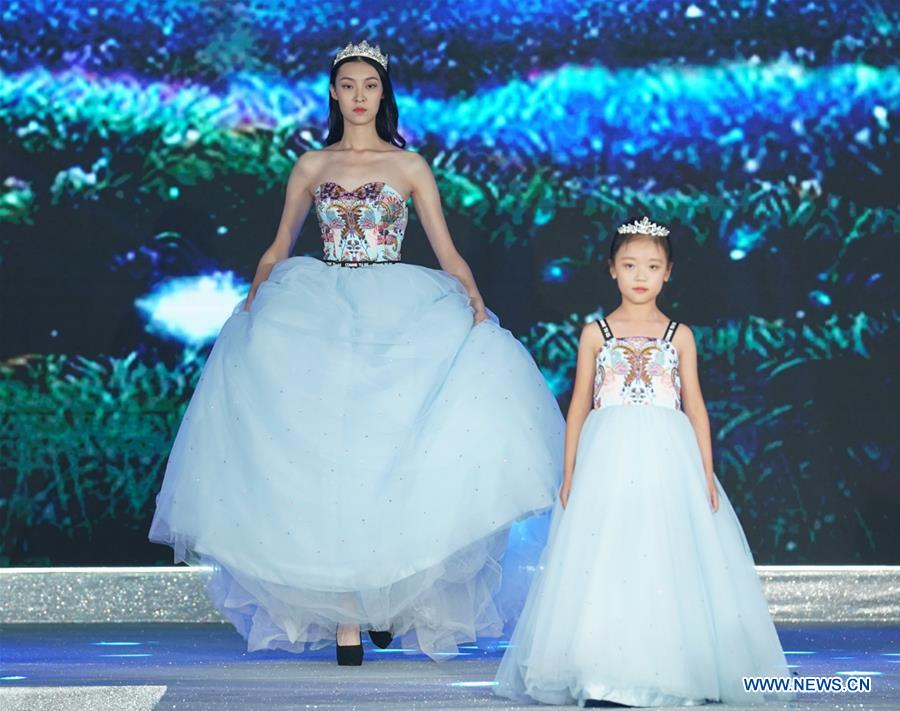 Models present creations during the China International Children's Fashion Week in Shanghai, east China, Oct. 7, 2018. The fashion week ended on Sunday. (Xinhua/Chen Jianli)<br/>