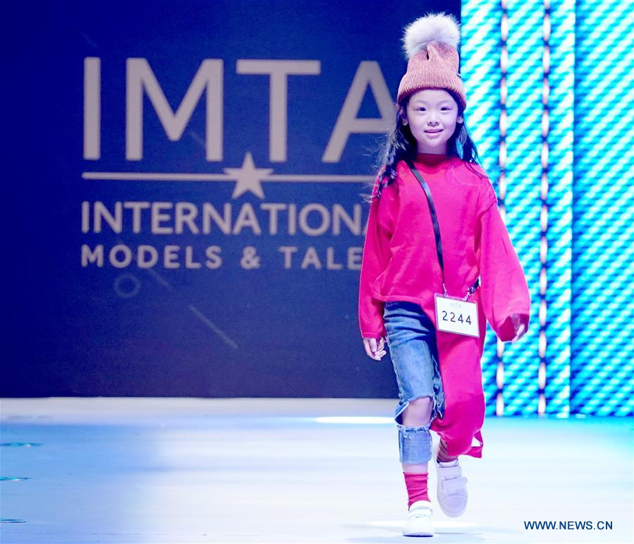 A model presents a creation during the China International Children's Fashion Week in Shanghai, east China, Oct. 5, 2018. The fashion week ended on Sunday. (Xinhua/Chen Jianli)<br/>