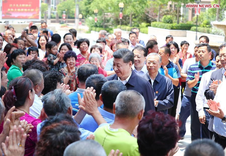 Chinese President Xi Jinping, also general secretary of the Communist Party of China Central Committee and chairman of the Central Military Commission, visits a community in Licang District during an inspection tour in Qingdao, east China's Shandong Province, June 12, 2018. (Xinhua/Xie Huanchi)<br/>