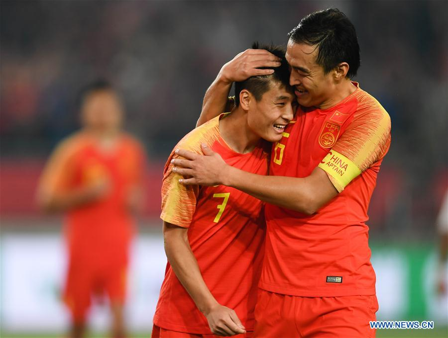 Wu Lei (L) of China celebrates after scoring with his teammate Feng Xiaoting during the CFA Team China International Football Match 2018 between China and Syria in Nanjing, capital of east China's Jiangsu Province, Oct. 16, 2018. China won 2-0. (Xinhua/Ji Chunpeng)<br/>
