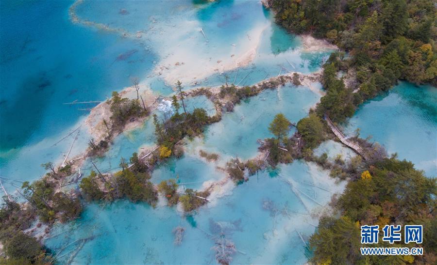 <br/>   修复后的火花海决堤后下游一角(2018年10月18日无人机拍摄)。<br/>