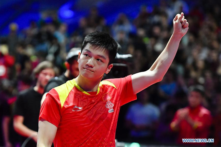 Fan Zhendong of China celebrates after winning the final match against Timo Boll of Germany at the 2018 ITTF Men's World Cup in Chessy, France on Oct. 21, 2018. Fan Zhendong won 4-1 and claimed the title. (Xinhua/Chen Yichen)<br/>