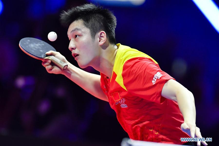 Fan Zhendong of China serves during the final match against Timo Boll of Germany at the 2018 ITTF Men's World Cup in Chessy, France on Oct. 21, 2018. Fan Zhendong won 4-1 and claimed the title. (Xinhua/Chen Yichen)<br/>