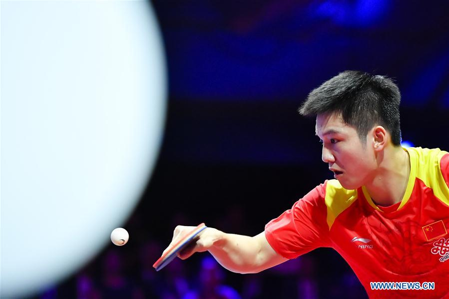 Fan Zhendong of China returns the ball during the final match against Timo Boll of Germany at the 2018 ITTF Men's World Cup in Chessy, France on Oct. 21, 2018. Fan Zhendong won 4-1 and claimed the title. (Xinhua/Chen Yichen)<br/>