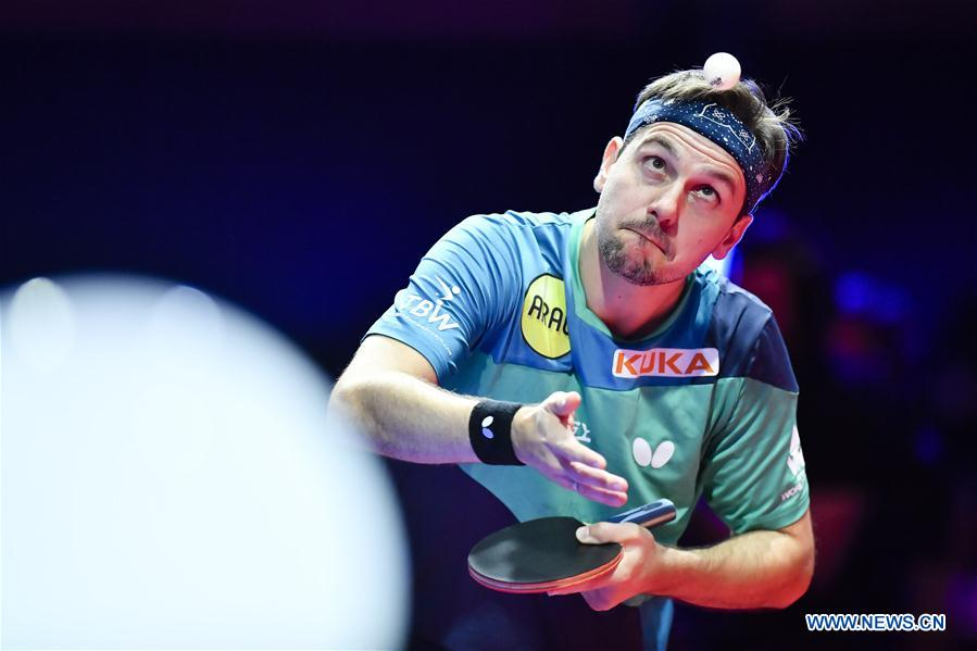 Timo Boll of Germany serves during the final match against Fan Zhendong of China at the 2018 ITTF Men's World Cup in Chessy, France on Oct. 21, 2018. Timo Boll lost 1-4. (Xinhua/Chen Yichen)<br/>
