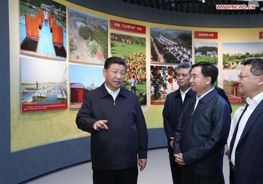 Chinese President Xi Jinping, also general secretary of the Communist Party of China Central Committee and chairman of the Central Military Commission, visits an exhibition on Guangdong's development during the past 40 years since the reform and opening up at a museum in Shenzhen, south China's Guangdong Province, during an inspection tour, Oct. 24, 2018. (Xinhua/Ju Peng)