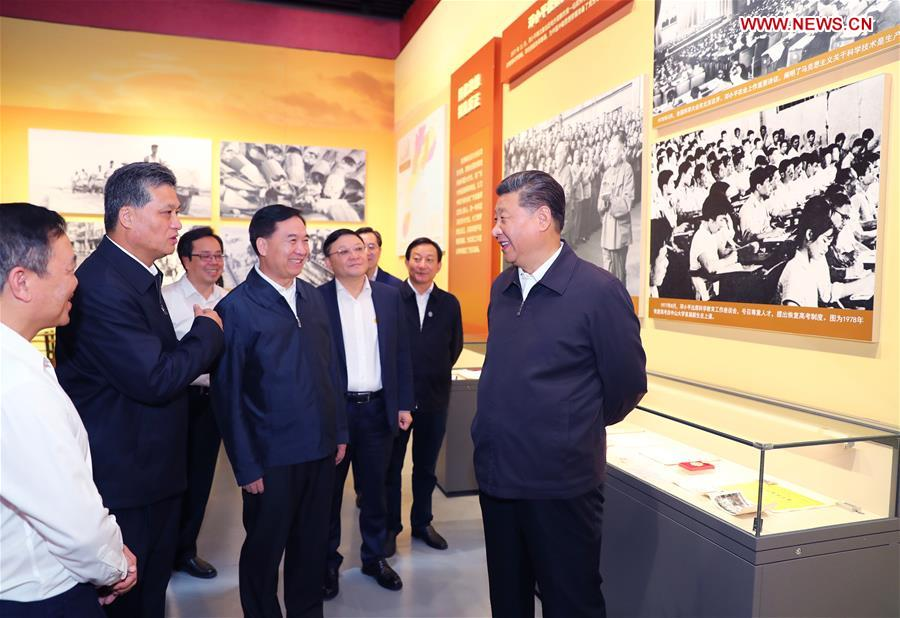 Chinese President Xi Jinping, also general secretary of the Communist Party of China Central Committee and chairman of the Central Military Commission, visits an exhibition on Guangdong's development during the past 40 years since the reform and opening up at a museum in Shenzhen, south China's Guangdong Province, during an inspection tour, Oct. 24, 2018. (Xinhua/Xie Huanchi)<br/>