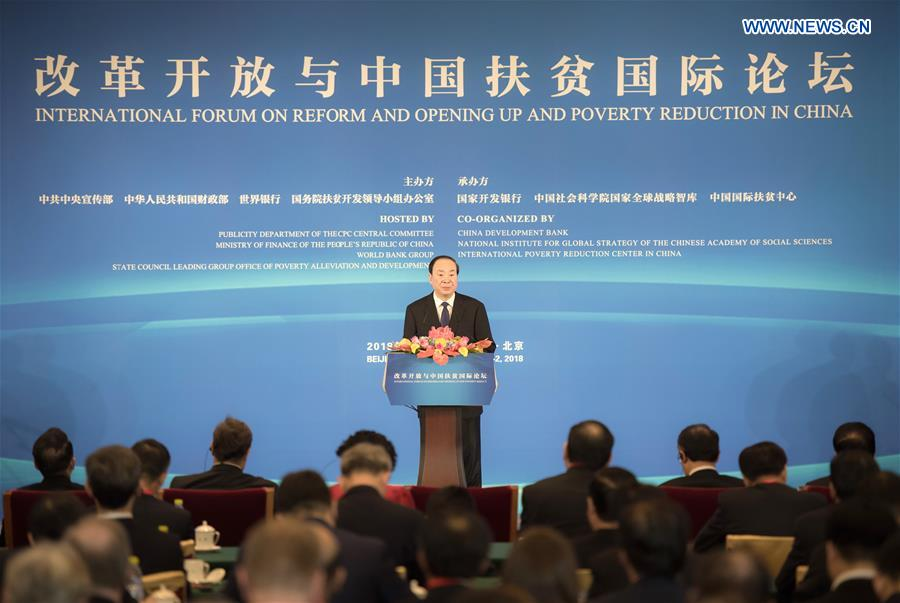 Huang Kunming, a member of the Political Bureau of the Communist Party of China (CPC) Central Committee and head of the Publicity Department of the CPC Central Committee, reads a congratulatory letter from Chinese President Xi Jinping to the International Forum on Reform and Opening Up and Poverty Reduction in China at the opening ceremony of the forum in Beijing, capital of China, on Nov. 1, 2018. (Xinhua/Zhai Jianlan)<br/>