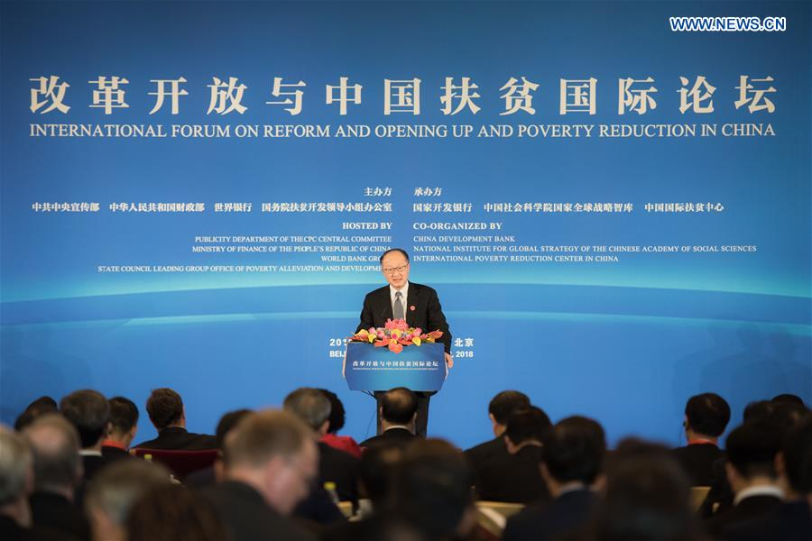 Jim Yong Kim, president of the World Bank Group, addresses the opening ceremony of the International Forum on Reform and Opening Up and Poverty Reduction in China held in Beijing, capital of China, on Nov. 1, 2018. The Forum opened here on Thursday. (Xinhua/Zhai Jianlan)